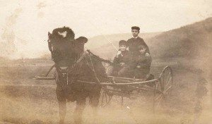 Sanford working the Homestead Farm in the early years with pulled wagon